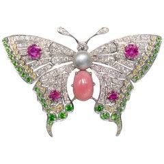 Conch Pearl, Demantoid Garnet, Ruby and Diamond 18 Karat Butterfly Brooch