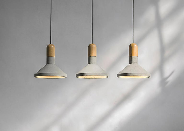 'Shang' concrete and bamboo lighting designed by Cantonese studio Bentu Design  Dimensions: Ø22 x 24 cm Cord: 2 Meter black Light source: E14 LED  Wattage: 3 W   Bentu Design's furniture derives its uniqueness from the simplicity of its