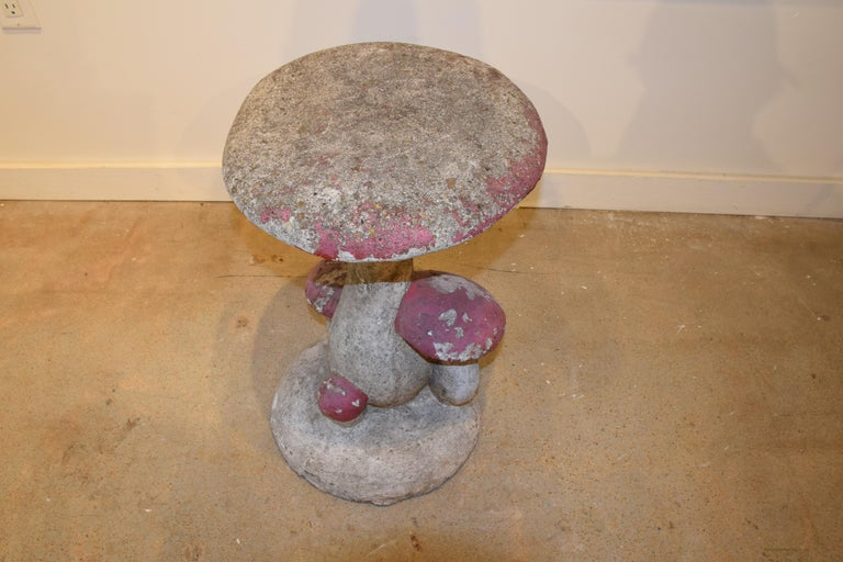 Found in France, this cement cluster of mushrooms serves well as a whimsical garden element. This strong sturdy could also be used as a unique end table or stool.