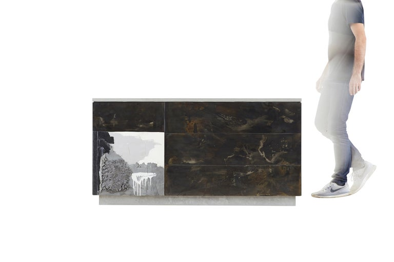 C-3 integrates three elemental materials, concrete, steel and wood. Stefan Rurak applies his unique concrete art treatment to the door. (Please note each piece will vary with unique drawings and the image is only an example) The counter-top as well