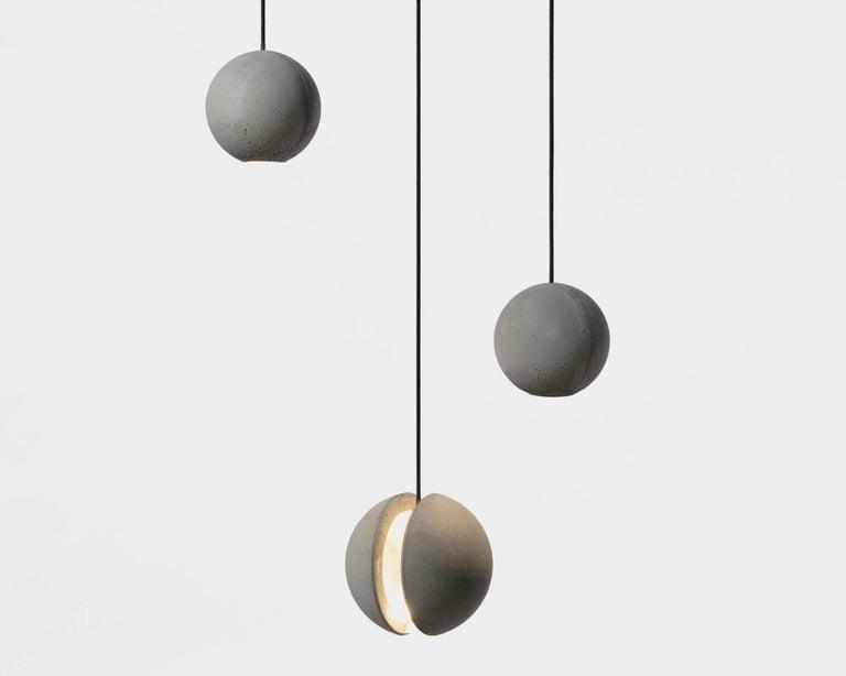 Moon M - Pendant lamp by Bentu Design  Concrete Ø130 × H 127mm 1kg Light source: G4 200lm 2700K AC 100-240V 50-60Hz 9W IP20  Cord: 3m black Ceiling rose: 110mm  Bentu Design's furniture and lightings derive its uniqueness from the