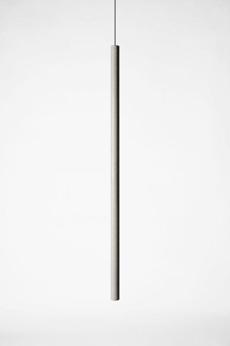 Concrete ceiling lamps designed by Cantonese studio Bentu design.  Three sizes available. Sold individually.   Material: Concrete, demolition leftover concrete Size: Ø 34×200 mm Ø 34×400 mm Ø 34×1000 mm Color: Cement grey Cord: 2m,