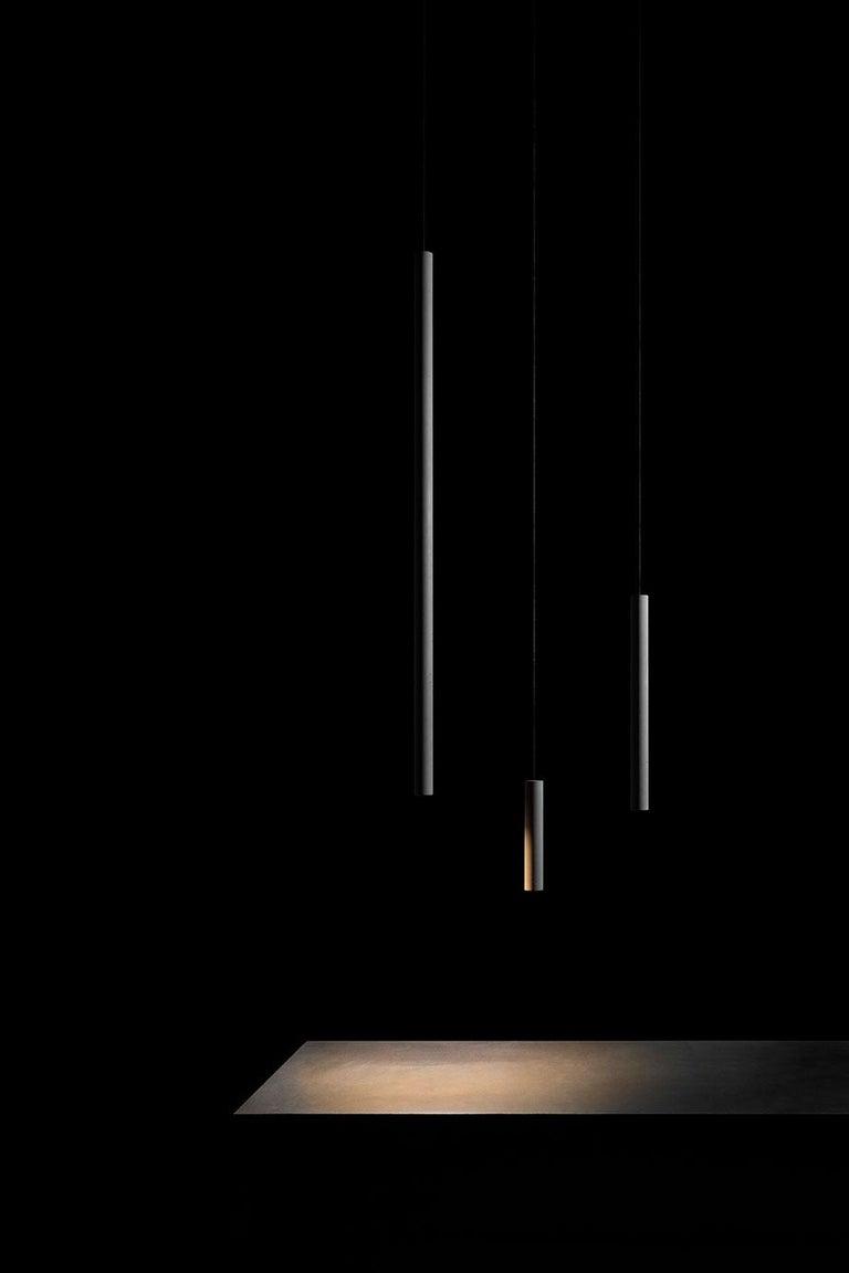 Concrete ceiling lamps designed by Cantonese Studio Bentu design.  Material: Concrete, demolition leftover concrete Size: Ø 34×200 mm Weight: 0.37 kg Color: Cement grey Cord: 2m, black Light source: G4 LED 3W 185-220V 80Ra 250LM 3000K (compatible