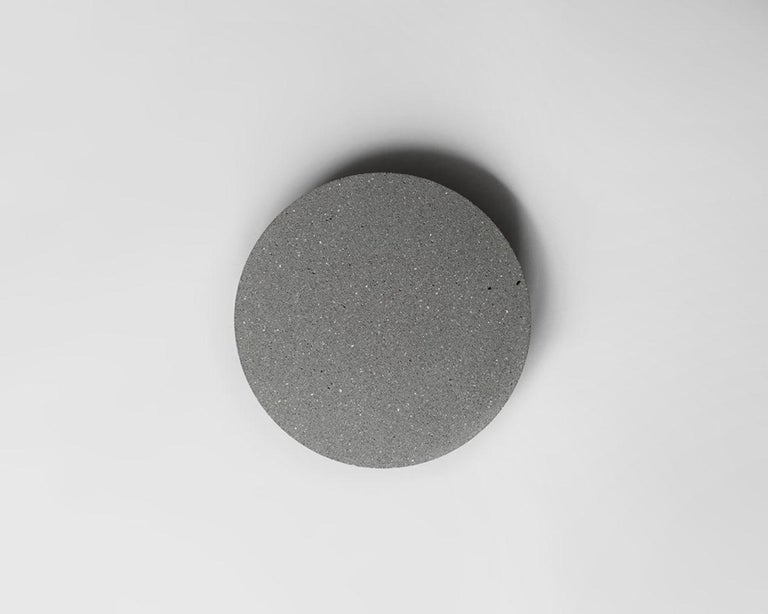 Pin concrete lighting designed by Cantonese studio Bentu Design  Dimensions: Ø26 x 6 cm Light source: LED Panel AC LED 3W 185-240V 80Ra 295LM 3000K (US compatibility) Suitable for outdoor: IP65   Bentu Design's furniture derives its