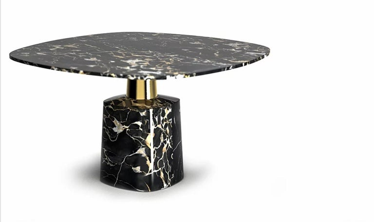 Cone marble dining table by Marmi Serafini Materials: Marble and brass Dimensions: 140 x 140 H80 cm  Elegant table defined by a clean and sophisticated lines stronlgy characterized by a metal leg that at the same time divides and still unify the