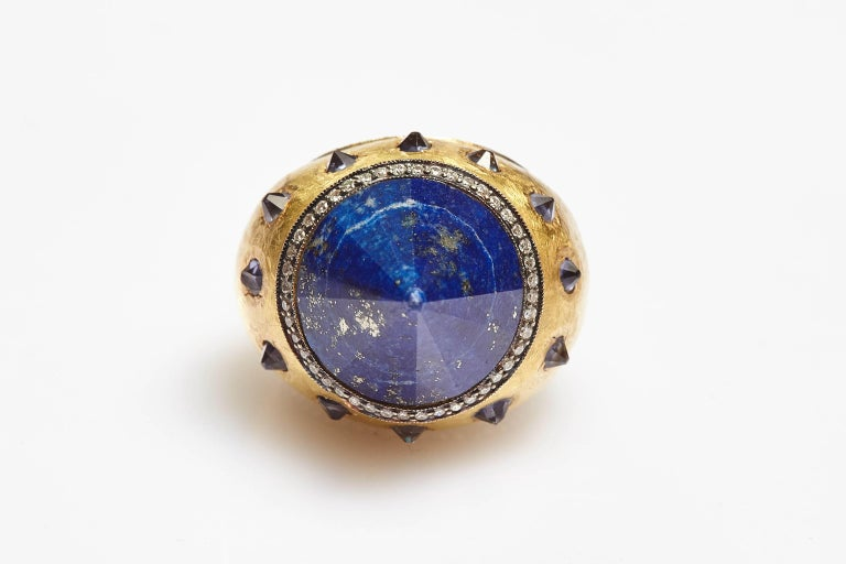 An unusual cocktail ring in 18kt yellow gold showcasing a sodalite cone, highlighted by diamonds and smaller sodalite elements. Made in Italy, circa 1970s