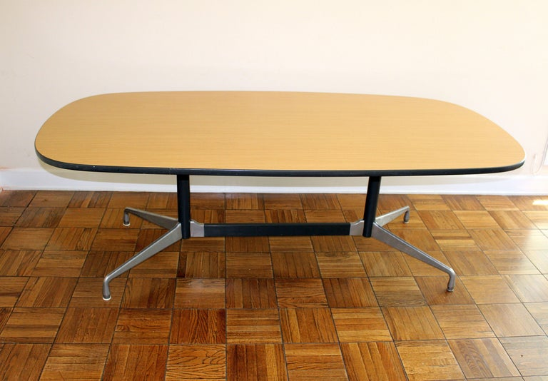 Formica tabletop aluminum base it can be use as a dining room or conference table .