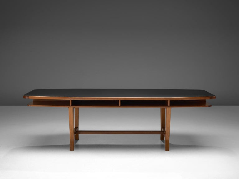 Dining table, teak and walnut, Germany, 1960s  Well designed rectangular-hexagon dining-/conference table with double top and robust yet elegant shaped legs. The black lacquered top has a modest and formal appearance, which combines very well with