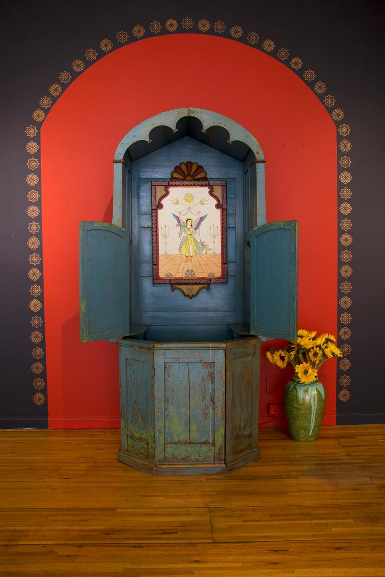 Unique confessional, likely from Northern Mexico, circa 1920. This catholic confession stall was hand made from pine.  Excellent patina from multiple layers of blue/green paint.  The screen is from hand cut tin. Provenance: prominent private