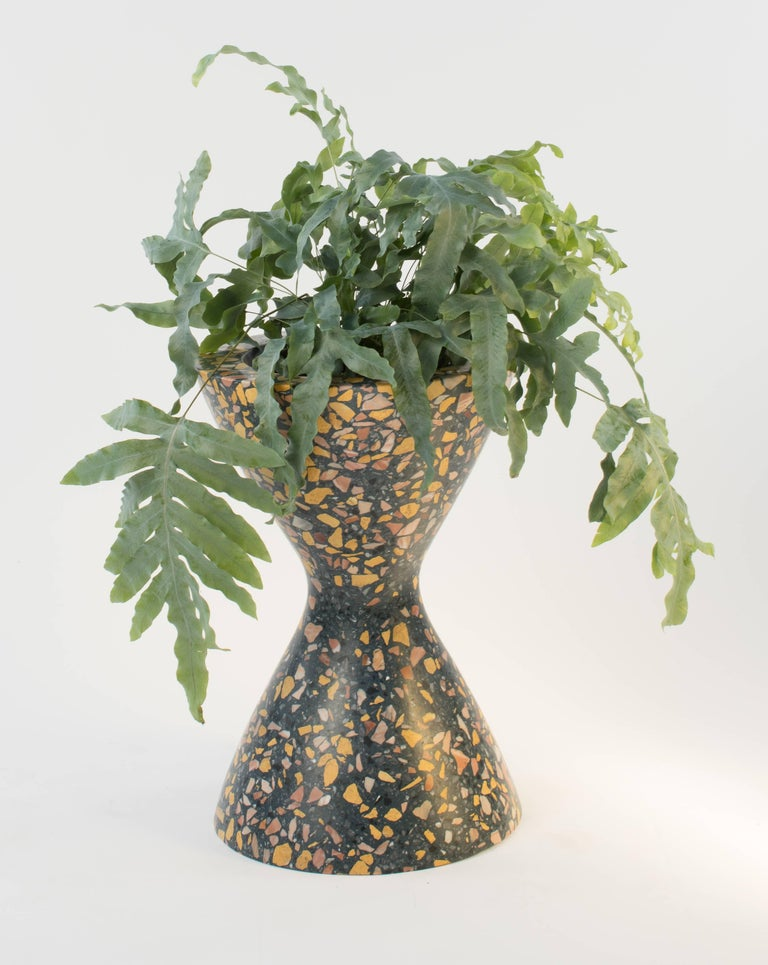 The Confetti planter casts the forms of iconic midcentury designs in terrazzo. A statement piece that is equally at home poolside or in the living room, this planter makes a big impression. Designed by Rachel Bullock and Molly Purnell of Laun in