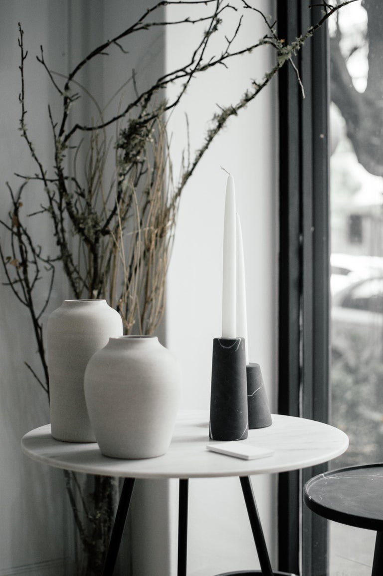 Two candleholders in Monterrey black marble. Handmade in México by local craftsmen.   Dimensions:  Small: 10 D x 10 W x 10 H cm Large: 6 D x 6 W x 15 H cm.