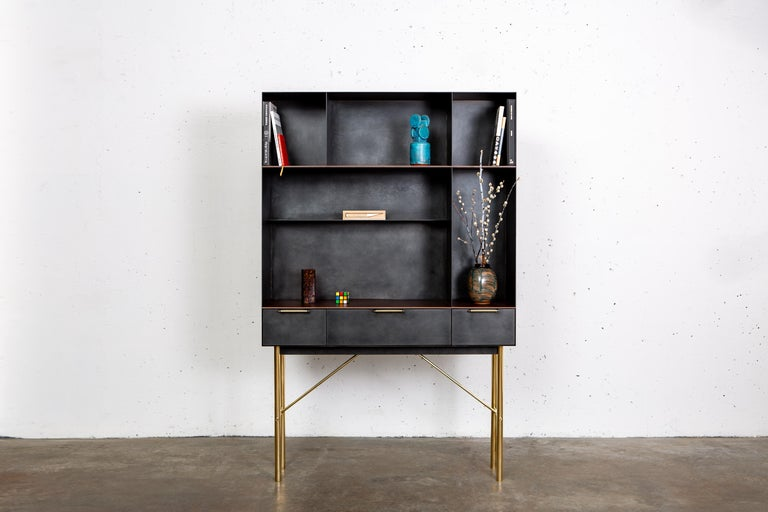 The Connect Bookcase is emblematic of the contemporary interweaving of mass manufacturing and traditional joinery technique. Construction and fastening details remain as evidence of process and are integral to the final piece. Mechanical connections