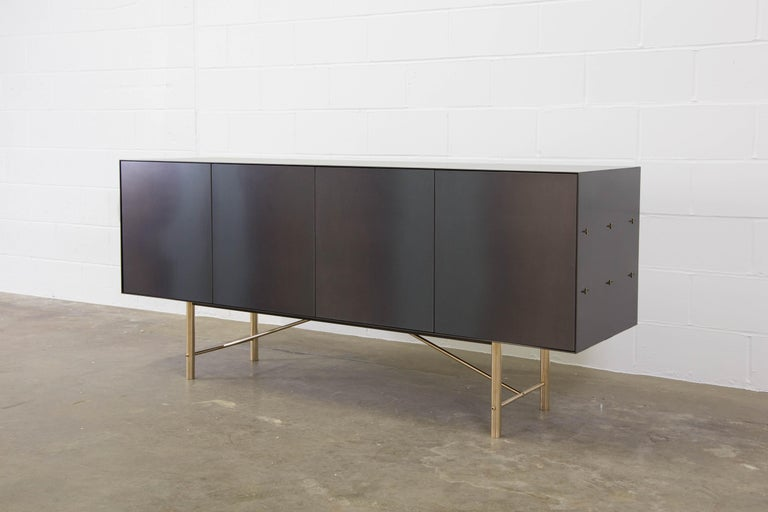The Connect credenza is emblematic of the contemporary interweaving of mass manufacturing and traditional joinery technique.  Construction and fastening details remain as evidence of process and are integral to the final piece. Mechanical