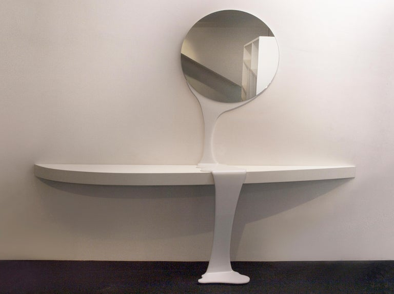 Consolable, created by the art-designer Raoul Gilioli, is a console, composed of a mirror and a functional and aerodynamic top .The two elements are connected by a plexiglass flow, that becomes the aesthetic leg of the console. The designer has