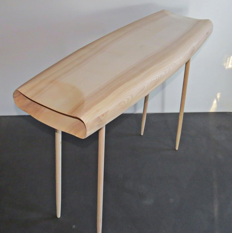 These consoles are made by hand. The hollow body is finely worked out and is gentle in its shape and shape like a cloud. The organic design looks like a sculpture, very light. The legs are screwed in with wood thread. Wood here ash - but I also