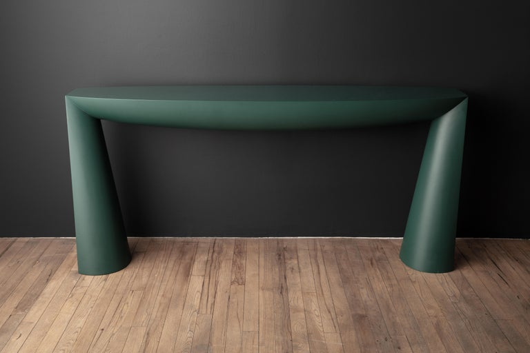First exhibited at the Galerie Vidid in Rotterdam, the Console table of Aldo Bakker depicts the simplest design concept of a table: two legs and a surface. The legs are an elongation of the line created by the tabletop. The tabletop and the base of