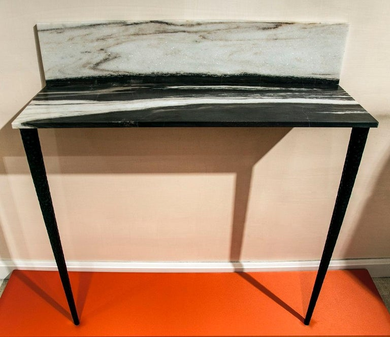 Sospesa is a console in Panda marble and graven wood legs.  Sospesa belongs to the Capsule Collection 2018 by architect Guido Ciompi who designed a collection for Tuscan furniture makers Turini & Werich in collaboration with Fiammetta V Home