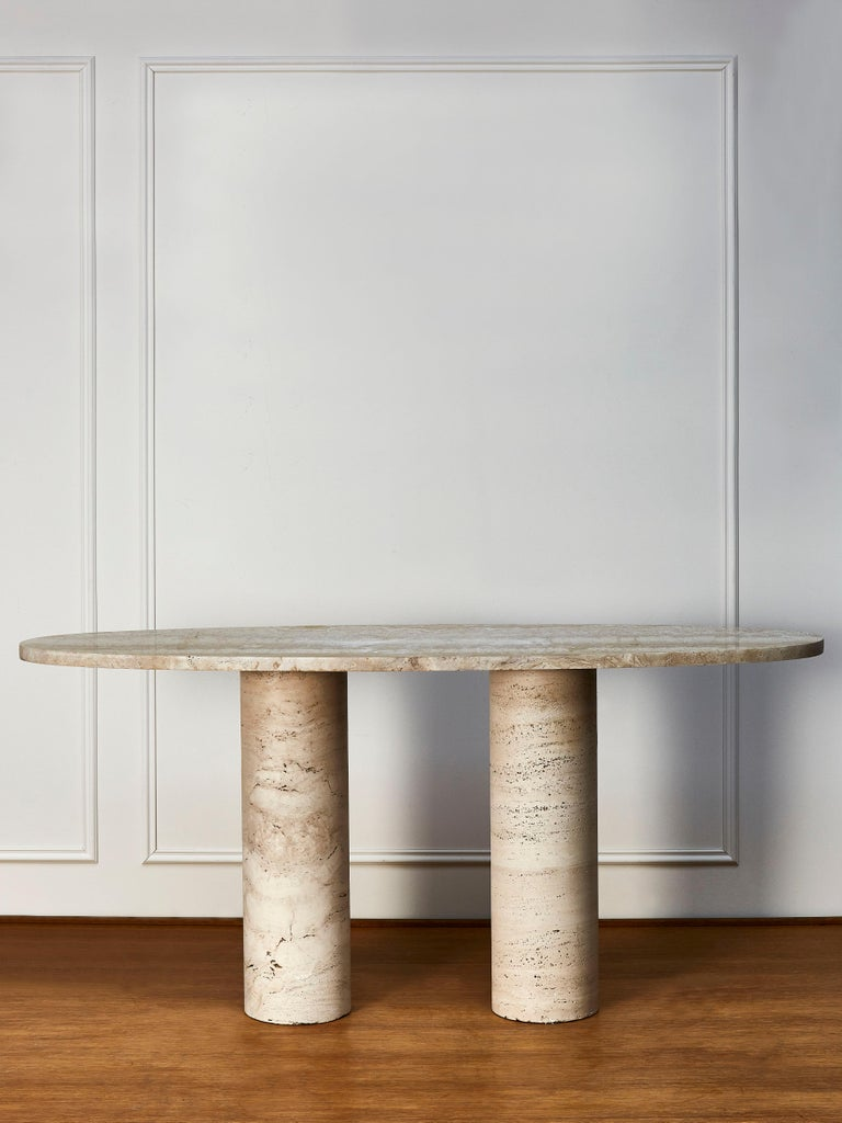 Beautiful console table made entirely made of massive travertine stone top, on 2 tubular feet also made of massive travertine stone. Creation by Studio Glustin.