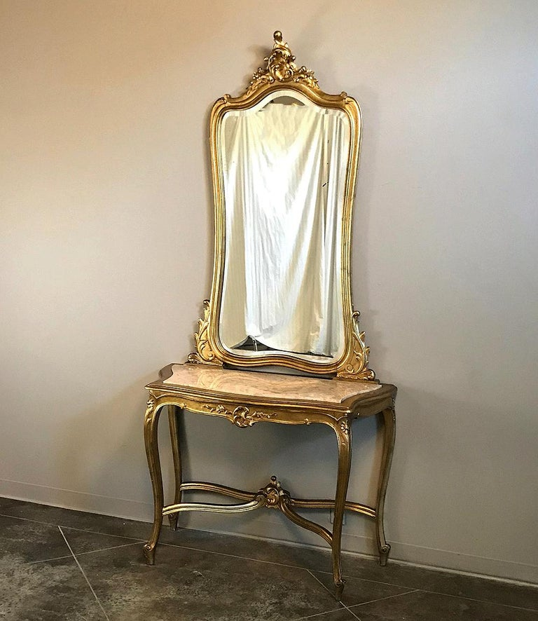 19th century Italian Rococo giltwood marble-top console and mirror will make any entryway a spectacular one! Also ideal antique furniture for stairwells, between windows, and other such niches, such pieces bring the luxury of a marble top surface,