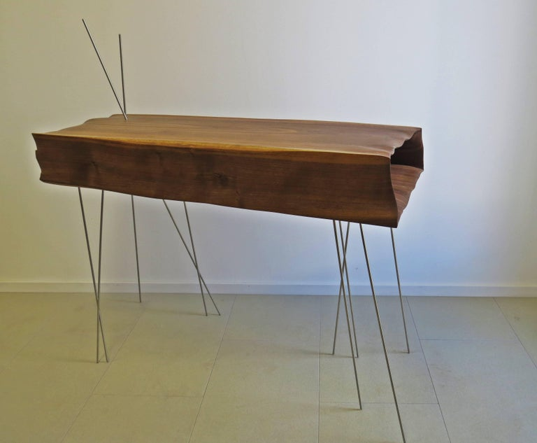 Console more sculpture like furniture.