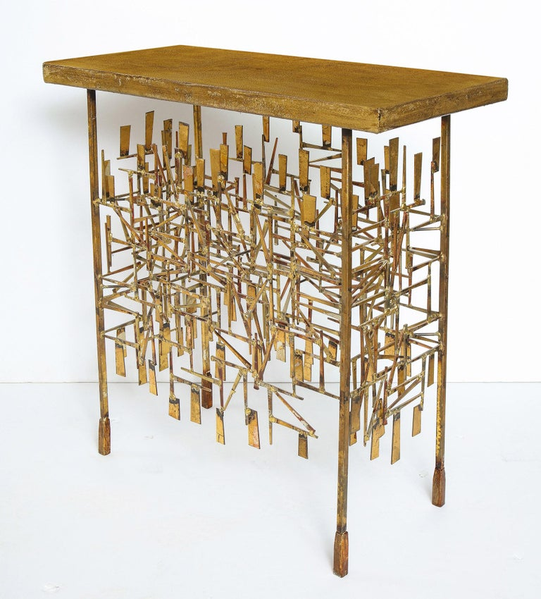 A unique gilt metal console table, by William Bowie