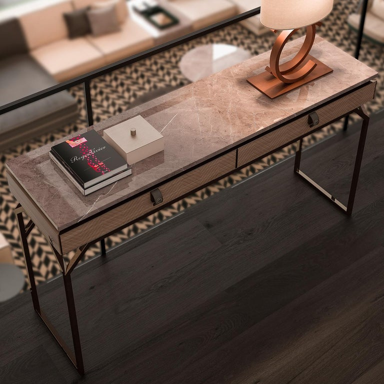 Simple, clean lines make this console table the perfect addition to compliment the decor in your contemporary style home. With a marble top, 2 drawers featuring an engraved design and a sturdy metal base, the table is both functional and
