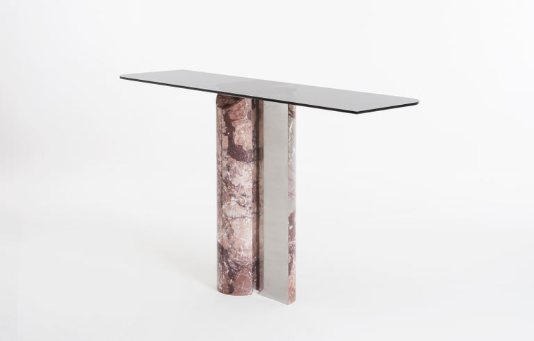 Console table designed by Andrea Bonini, with Solid marble colloumns, hand made created with steel metal finished, the top is in smoked glass. the fix system for the top and base is a master detail of the piece and easy to fix. This piece is