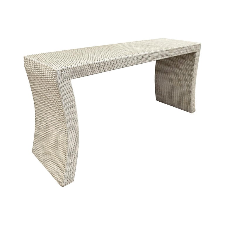 Karl Springer style console table in white wicker with curving sides, American, 1970s. This console is very chic.