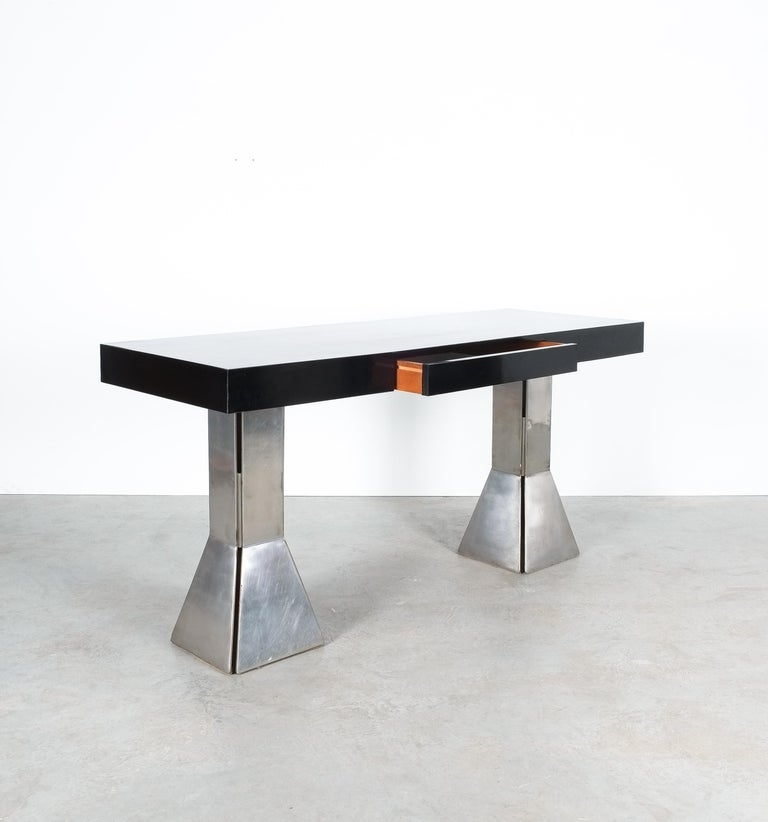 Unique black formica bespoke writing desk with heavy steel feet and drawer, Italy, circa 1970-1980.  Perfectly sized desk or console table with a large drawer (21