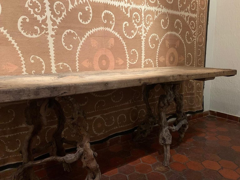 A large console table with one slab oak 17th century top on 19th century Winebranch Consoles. The top beautifully dryed with old insets and the trestles incrusted with old paint remains.