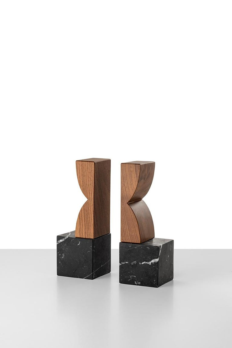 Constantin 1 is a simple but charming bookend couple with a geometric shape. The body is in Marquina black marble. The top in solid Canaletto walnut. A perfect present, closed in an elegant gift box. Constantin collection owes its name to its