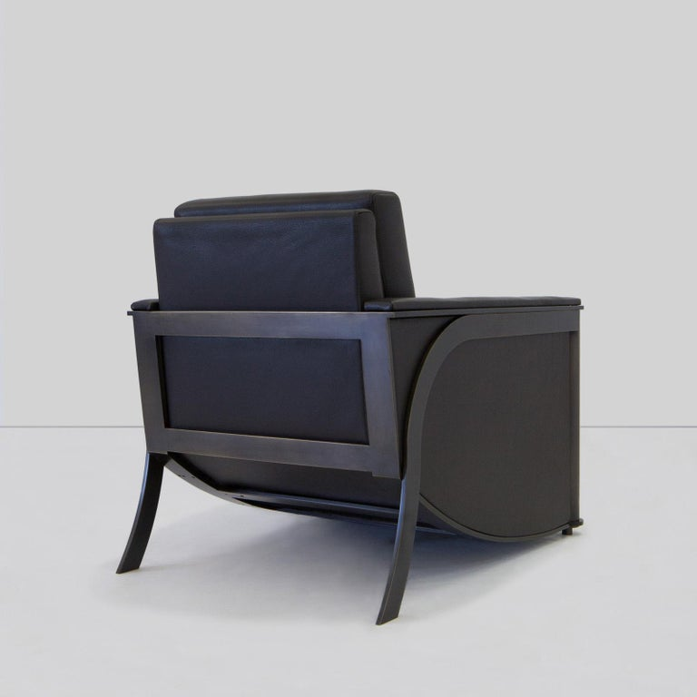 Constantine club chair from Blackbarn Bronze Age collection by Mark Zeff, bronze finished frame with leather upholstery.  Available with fabric upholstered back and seat.  Bronze Age collection by Mark Zeff Bronze Age is a furniture collection