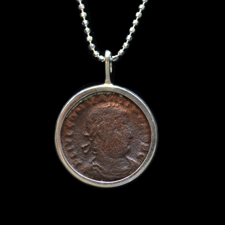 Authentic roman bronze coin  Ca. 337-361 CE mounted on contemporary silver necklace. Ready to be worn!  Flavius Julius Constantius, the second son of Constantine I and Fausta, he ascended to the throne with his brothers Constantine II and Constans