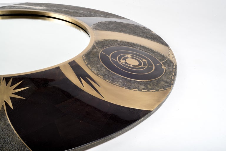 The constellation dark mirror is a statement piece with it's celestial inspired roots. The mirror can be hung in 3 different ways. Available in a smaller size and cream finish (image at end of the slide). The shagreen is hand-dyed by artisans and