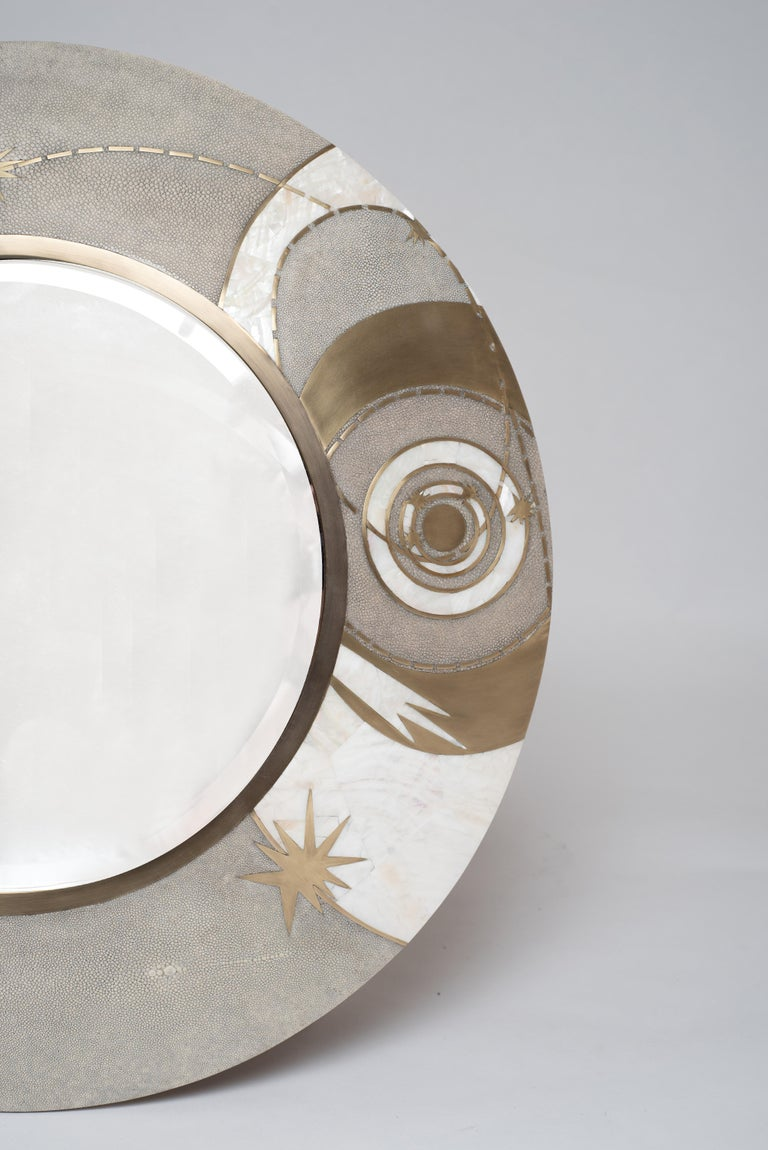 The Constellation light mirror is a statement piece with it's celestial inspired roots. The mirror can be hung in 3 different ways. Available in a larger size and black finish (image at end of the slide). The shagreen is hand-dyed by artisans and