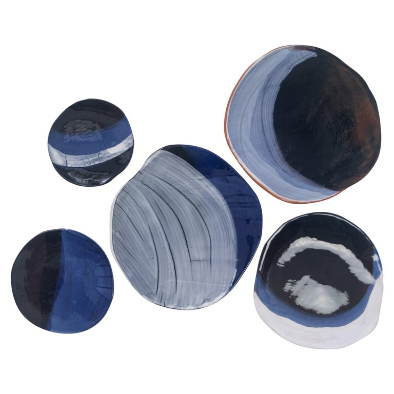 Unique wall art: a series of 5 ceramics evoking the phases of the moon The pieces can also be arranged on a large table.  Diameters are: 8.5
