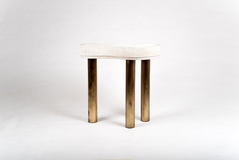 """The constellation side table is whimsical and elegant with it's amorphous shape. The shagreen is hand-dyed by artisans and the designer calls the final finish """"Antique Natural"""" shagreen. The piece has beautiful discreet details of a metal"""
