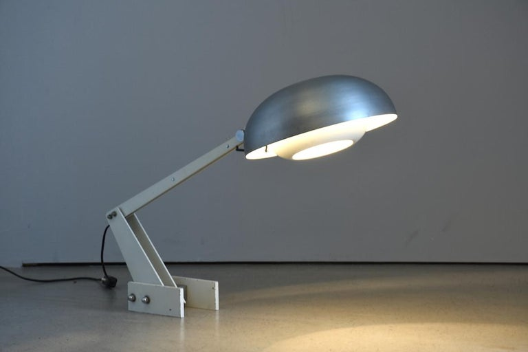 Constructivist table lamp with brushed aluminium lampshade, 1960s. Metal construction. Made in a constructivist manner. Swivel lampshade. Designer unknown. Switzerland
