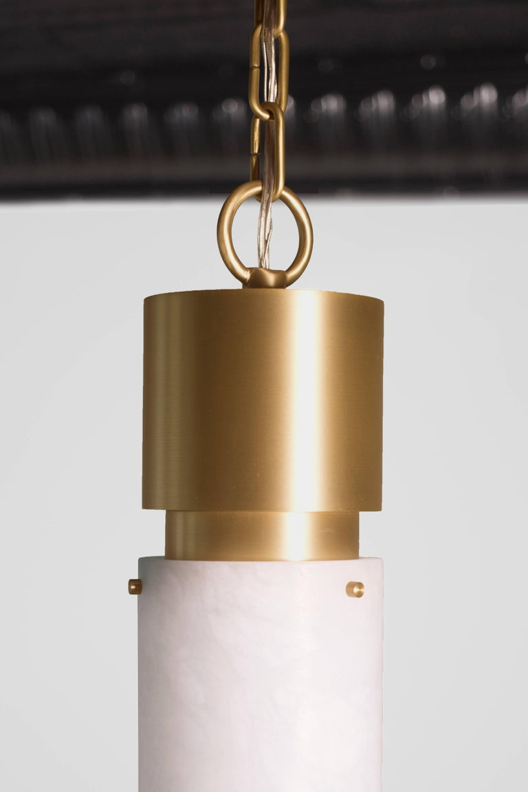 This contemporary light made of brushed brass and alabaster is part of the Orphan Work brand and can be used as a ceiling pendant or flush mount.   ORPHAN WORK is a new identity for lost designs from Material Lust's own archive. We have designed