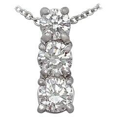 Contemporary 0.65 Carat Diamond and Platinum Trilogy Pendant