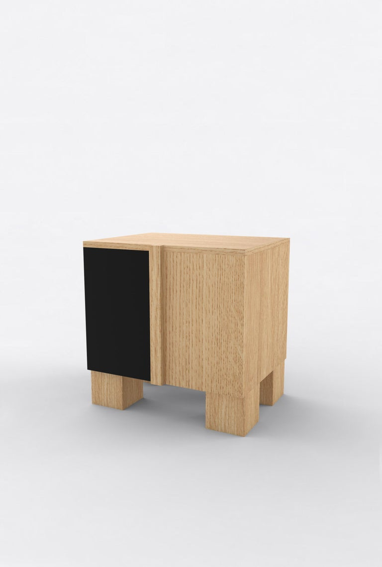 """Orphan Work 100 Bedside, 2019 Shown in oak and black. Available in natural oak with painted door.  Measures: 24"""" W x 15"""" D x 22"""" H 2 doors with adjustable shelves.   Additional dimensions, materials or finishes available upon request.  Prices may"""