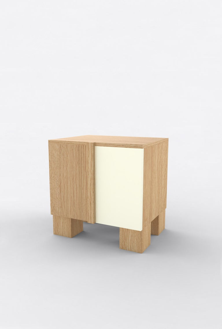 """Orphan Work 100 Bedside, 2019 Shown in oak and white. Available in natural oak with painted door. Measures: 24"""" W x 15"""" D x 22"""" H 2 doors with adjustable shelves.  Additional dimensions, materials or finishes available upon request.  Prices may"""
