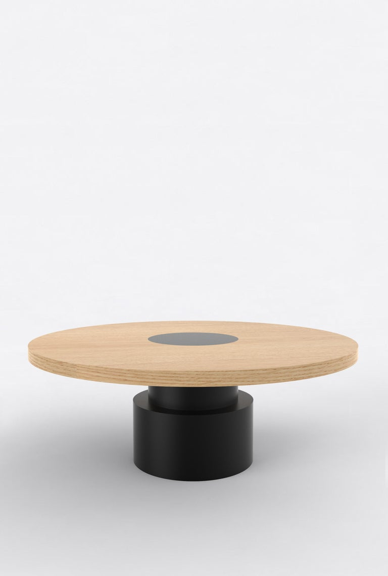 "Orphan work 100 Coffee Table, 2019 Shown in oak and black. Available in natural oak with painted base. Measures: 42"" diameter x 16"" height  Additional dimensions, materials or finishes available upon request. Prices may vary depending.    Orphan"