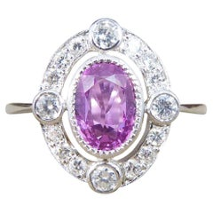 Contemporary 1.05ct Pink Sapphire and Diamond Halo Ring Mounted in Platinum