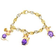 Contemporary 10.70 Carat Amethyst Ruby 14 18 Karat Two-Tone Gold Charm Bracelet
