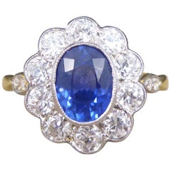 Contemporary 1.25 Carat Sapphire and Diamond Cluster Ring in 18 Carat Gold