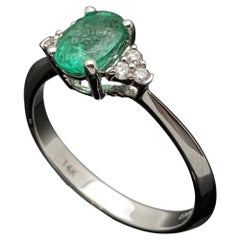 Contemporary 14 Karat White Gold Emerald and Diamond Ring