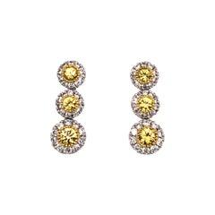 Contemporary 18 Karat White Gold Fancy Yellow Diamond Graduating Drop Earrings