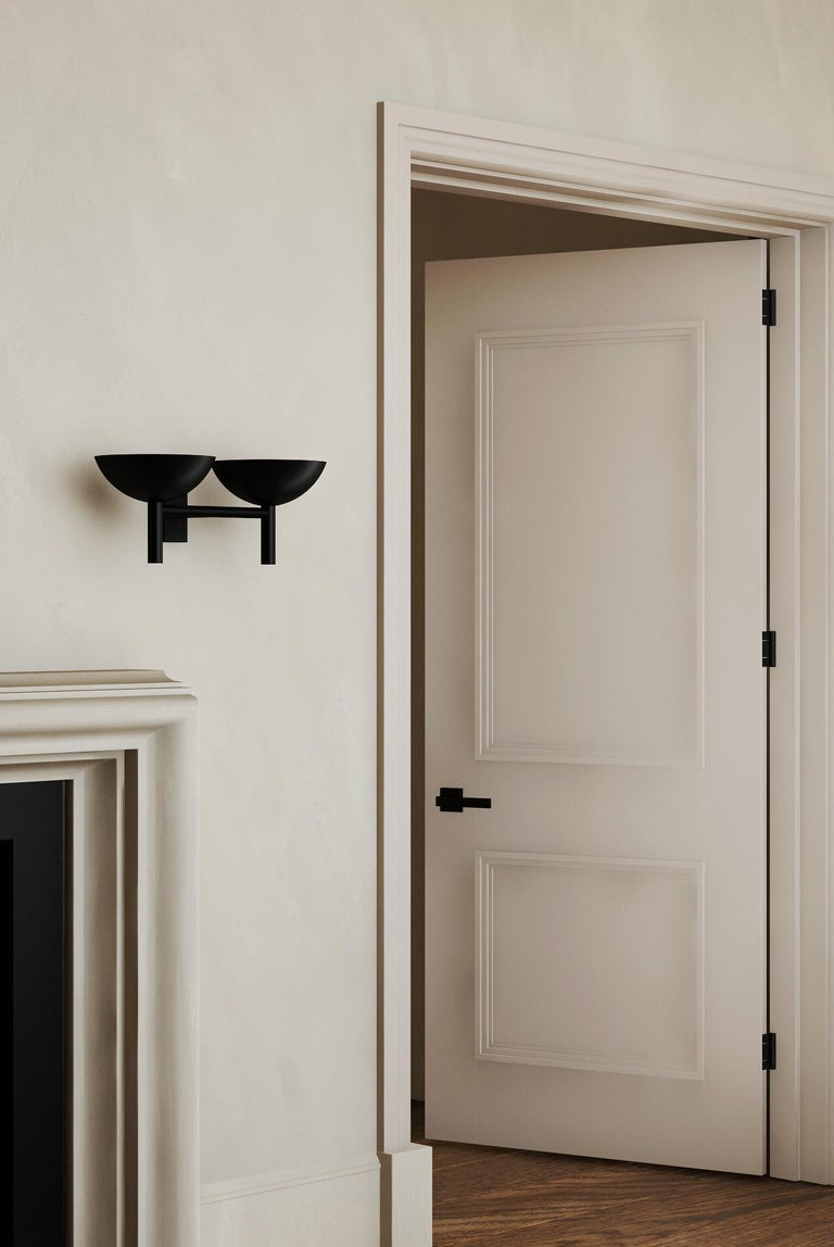 """Orphan work 200 Double Sconce BLK, 2020 Shown in blackened brass Available in brushed brass and blackened brass Measures: 7"""" H x 17"""" W x 8.5"""" D UL approved Holds (2) 60W candelabra bulb LED bulb recommended  Orphan work is designed to complement."""