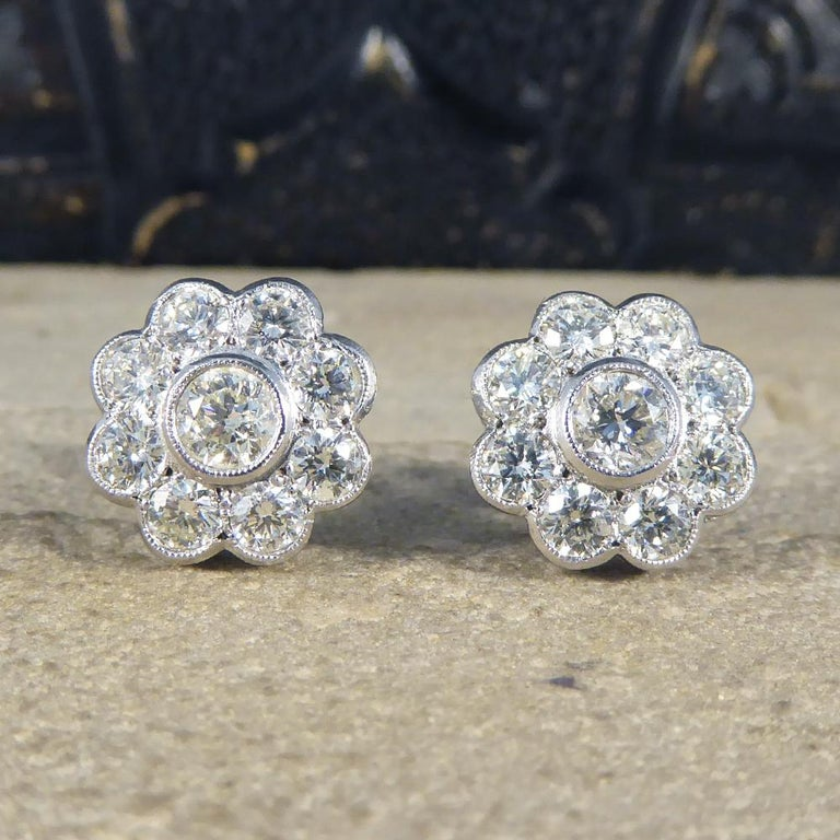 A lovely piece that will stand the test of time, these beautiful Diamond cluster earrings resemble a floral shape with a Diamond in the centre surrounded by 8 slightly smaller Diamonds. Both earrings together hold a total of 2.50ct Diamonds